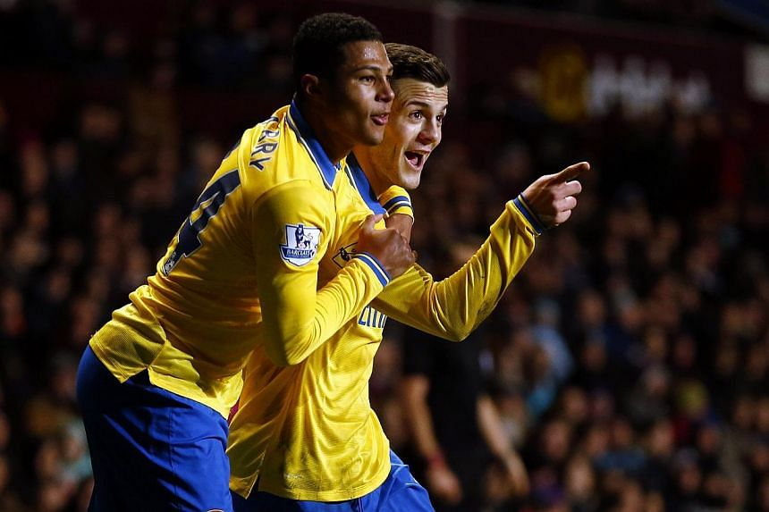 Arsenal's Jack Wilshere (right) celebrating with teammate Serge Gnabry after scoring their first goal against Aston Villa during their English Premier League match at Villa Park in Birmingham, Jan 13, 2014.
