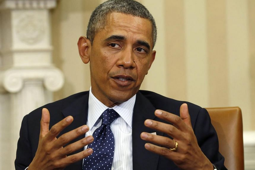 Mr Barack Obama insisted on Monday, Jan 13, 2014, he had faith in his Afghanistan strategy, after a book by former his defence secretary claimed the President had soured on his troop surge and its commanders. -- PHOTO: REUTERS