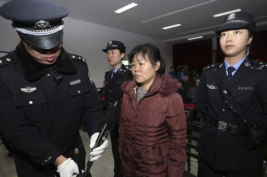 A Chinese court on Tuesday convicted an obstetrician, Zhang Shuxia (centre), of abducting newborn babies and gave her a suspended death sentence. -- FILE PHOTO: REUTERS