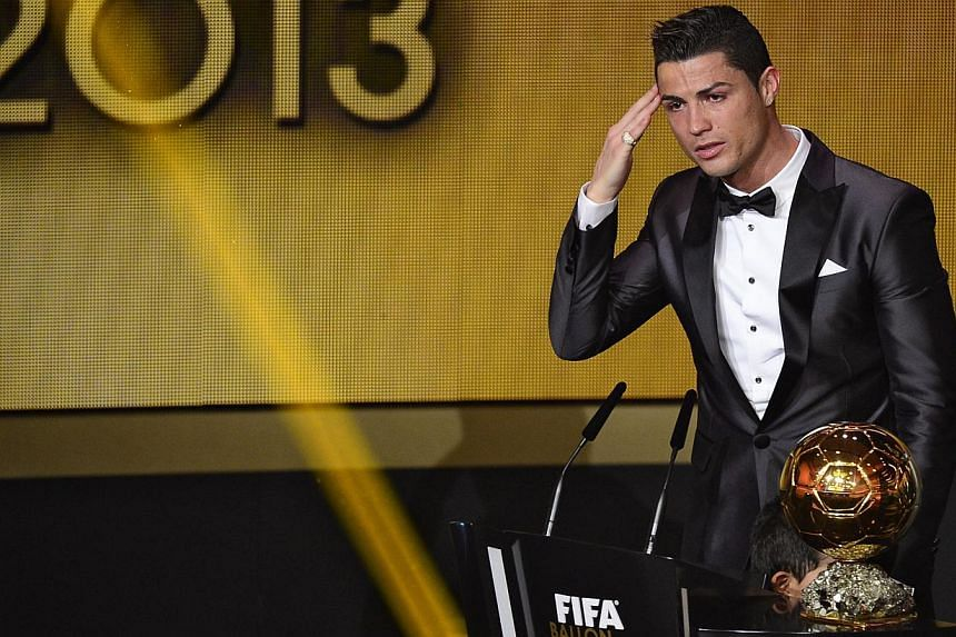 Real Madrid's Portuguese forward Cristiano Ronaldo delivers a speech after receiving the 2013 Fifa Ballon d'Or award for player of the year during the Fifa Ballon d'Or award ceremony at the Kongresshaus in Zurich on Jan 13, 2014. -- PHOTO: AFP