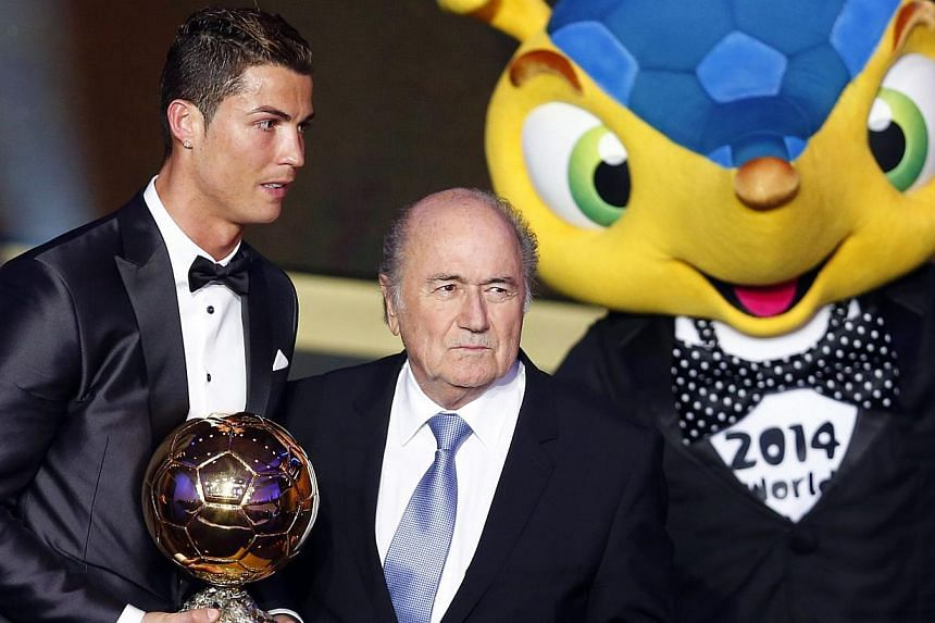 Portugal's Cristiano Ronaldo poses with Fifa President Sepp Blatter (centre) and 2014 World Cup mascot Fuleco after being awarded the Fifa Ballon d'Or 2013 in Zurich on Jan 13, 2014. -- PHOTO: REUTERS