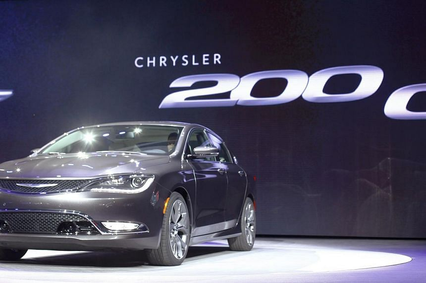 The new Chrysler 200 C sedan is unveiled during the press preview day of the North American International Auto Show in Detroit, Michigan on Jan 13, 2014. Chrysler took aim at its competition Monday with an aggressive redesign of its 200 midsized seda