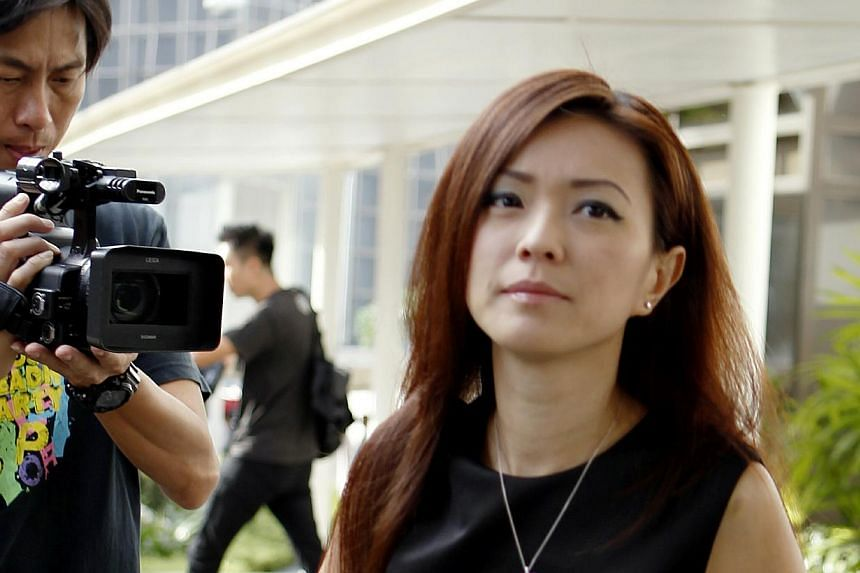 Serina Wee Gek Yin arrives at the Subordinate Courts on Tuesday, Jan 14, 2014.  -- ST PHOTO: WONG KWAI CHOW