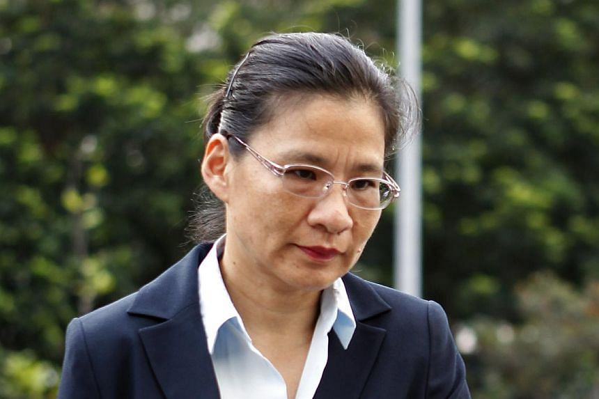 Auditor Tiang Yii arrives at the Subordinate Courts on Tuesday, Jan 14, 2014.  -- ST PHOTO: WONG KWAI CHOW