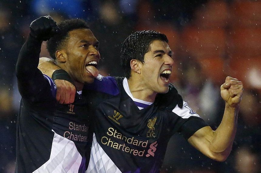 Liverpool's Luis Suarez (right) celebrates his second goal against Stoke City with teammate Daniel Sturridge during their English Premier League match at the Britannia stadium in Stoke-on-Trent, on Jan 12, 2014. Suarez thinks his enforced absence fro