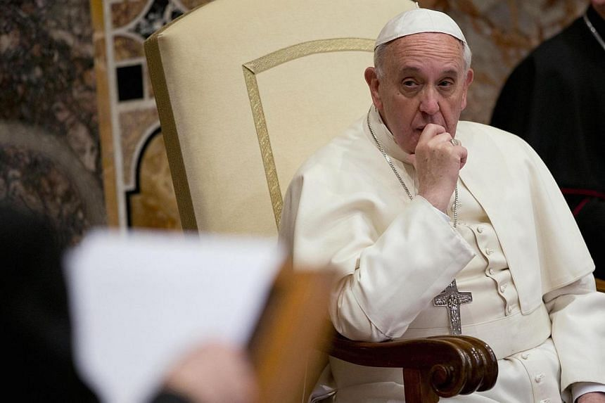 """Pope Francis attends an audience with the diplomatic corps at the Vatican on Jan 13, 2014. Pope Francis on Monday issued his strongest condemnation yet of abortion, calling it a symptom of a """"throwaway culture"""" that placed too little value on human l"""