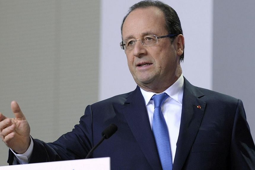 France's President Francois Hollande addresses a news conference during a European Union leaders summit in Brussels on Dec 20, 2013. President Francois Hollande will aim at a news conference on Tuesday to set out plans to revive the weak French econo