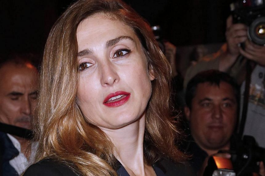 """A file picture taken on Sept 30, 2013 in Paris shows French actress Julie Gayet arriving to attend a ready-to-wear collection fashion show. French actress Julie Gayet has remained """"very calm"""" since allegations she was having an affair with President"""