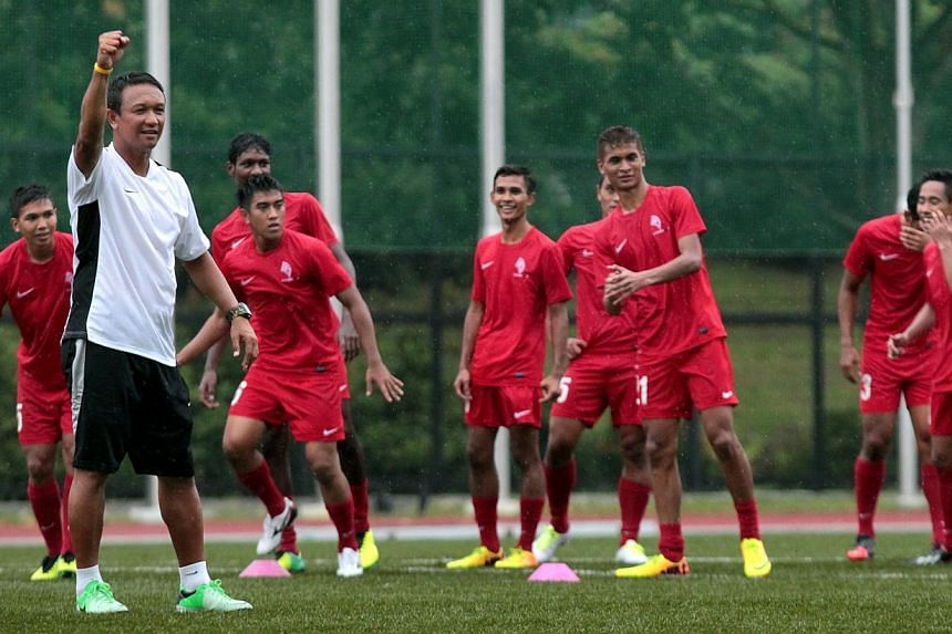 LionsXII coach Fandi Ahmad (in white) at the LionsXII squad's training session at ITE College Central on Dec 30, 2013. The Lions XII coach has set his sights on a top-three finish in this year's Malaysia Super League (MSL), with an eye on producing m