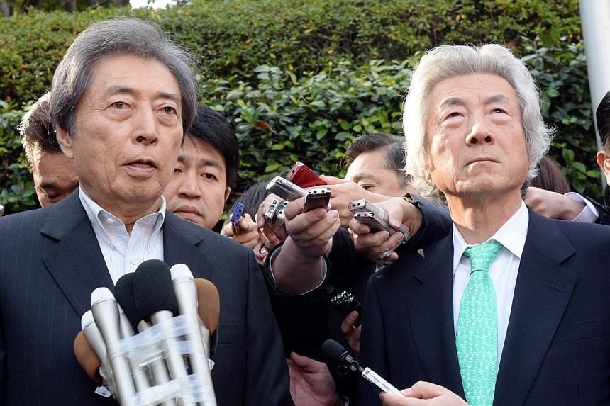 Former Japanese prime ministers Morihiro Hosokawa (left) and Junichiro Koizumi (right) speak to reporters on Jan 14, 2013. Mr Koizumi said on Tuesday he was backing Mr Hosokawam, a fellow former premier, in the race to become Tokyo governor, setting