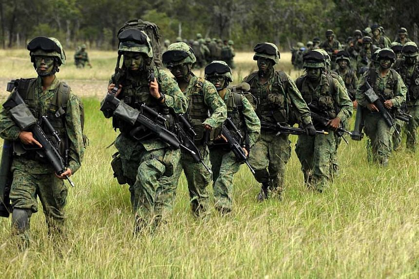 Officers from the Singapore Armed Forces (SAF) go through their drills during the Exercise Wallaby 2010, an overseas military exercise held in Rockhampton, Australia. Military personnel leaving the service can now apply for a new bond-free scholarshi