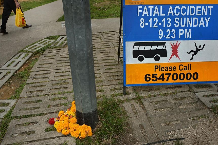Fresh flowers left at the accident site along Race Course Road on Dec 21, 2013 as a blessing for the worker who died. The accident sparked a riot in Little India by 400 people. The public hearing for the Committee of Inquiry (COI) on the riot will st