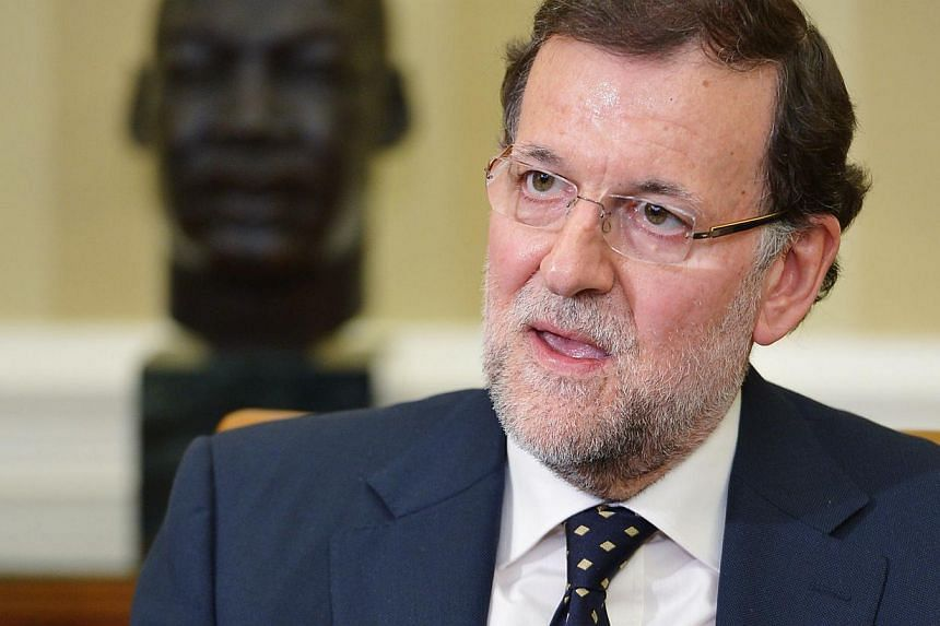"""Prime Minister Mariano Rajoy said on Monday after meeting with US President Barack Obama that Spain had received a """"satisfactory"""" explanation of reports that American spies bugged European leaders' phones. -- PHOTO: AFP"""