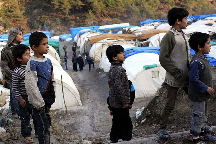 Syrian refugee children are seen in the al-Yamdiyeh refugee camp near the Syrian-Turkish border in Latakia province January 10, 2014. -- PHOTO: REUTERS