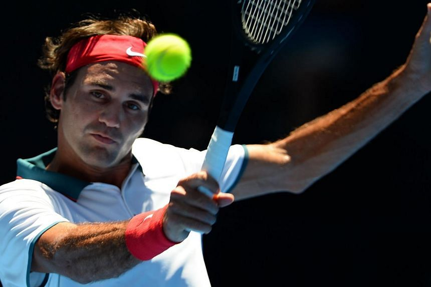 Switzerland's Roger Federer plays a shot during his men's singles match against Australia's James Duckworth on day two of the 2014 Australian Open tennis tournament in Melbourne on Jan 14, 2014. Federer kicked off his record 57th successive grand sla