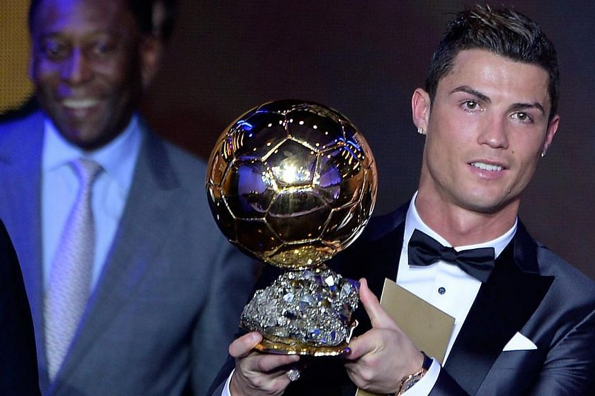 Real Madrid's Portuguese forward Cristiano Ronaldo poses with the 2013 Fifa Ballon d'Or award for player of the year during the Fifa Ballon d'Or award ceremony at the Kongresshaus in Zurich on Jan 13, 2014. -- PHOTO: AFP