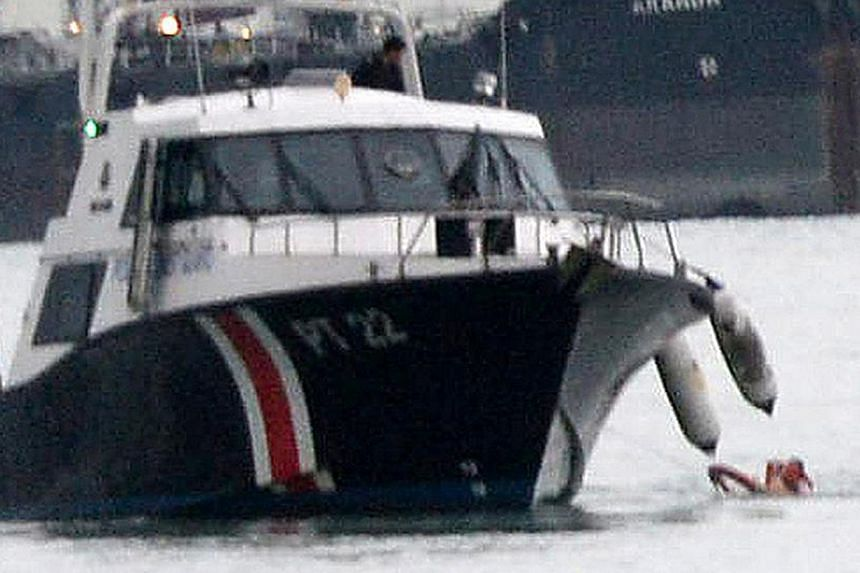 The Police Coast Guard rescuing Lim Ann Nee in the sea off East Coast Park on the evening of Nov 25, 2013. Lim, the woman accused of murdering her baby son, has been found fit to have her plea taken, but was of unsound mind at the time of the alleged