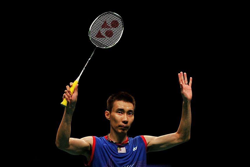 Malaysia's top-ranked badminton star Lee Chong Wei acknowledges the crowd as he celebrates his win against Tommy Sugiarto of Indonesia during their men's single final at the BWF badminton World Superseries Finals in Kuala Lumpur on Dec 15, 2013.