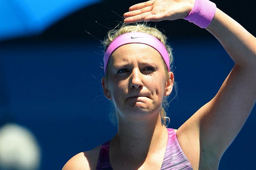Victoria Azarenka of Belarus celebrates after victory in her women's singles match against Sweden's Johanna Larsson on day two of the 2014 Australian Open tennis tournament in Melbourne on Jan 14, 2014. Top tennis stars were put through a punishing w