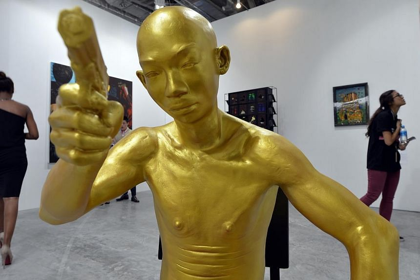 Aung Ko's sculptures made of fibreglass and gold paint titled Ko Shwe.Singapore's premier fair for international contemporary art kicked off on Wednesday night with unusually buoyant sales for homegrown artists. -- ST PHOTO:DESMOND FOO&nb