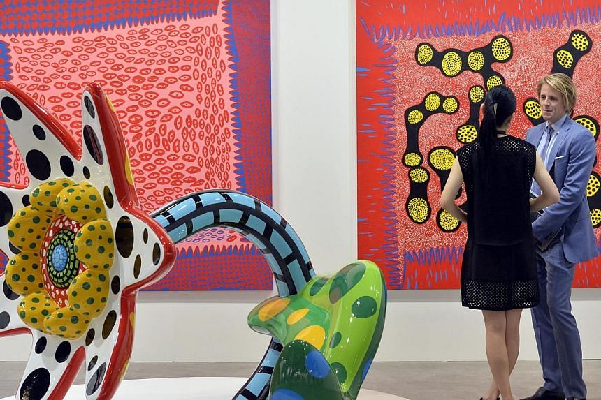 A collection of Japanese artist Yayoi Kusama's paintings and sculpture as seen at Ota Fine Arts gallery.-- ST PHOTO:DESMOND FOO