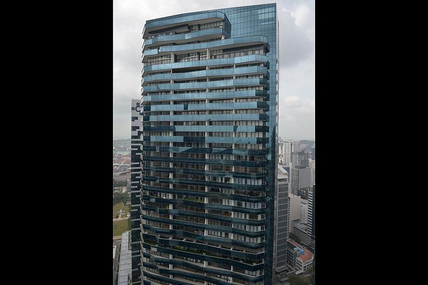 The management said there are residents living in only about 20 of the 221 units in Marina Bay Suites. So far, 203 units have been sold. -- ST PHOTO: KUA CHEE SIONG