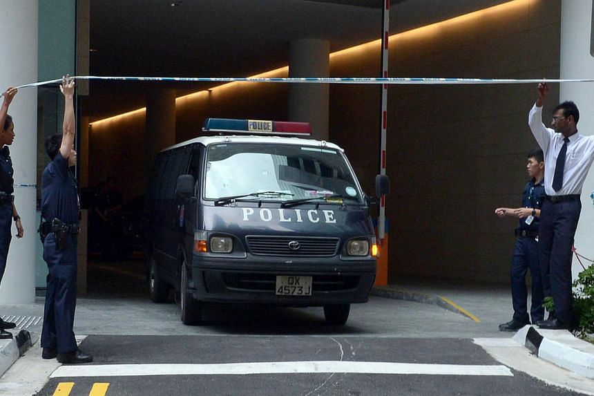 van leaving Marina Bay Suites carrying the bodies of the victims yesterday. The two security guards were found in a stationary service lift on the 65th floor which had its doors open. -- ST PHOTO: KUA CHEE SIONG