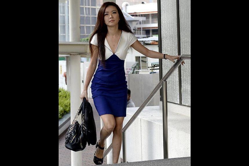Serina Wee turned up in court on Monday in a white and blue dress (above) from her new blogshop, Missy Stella. -- PHOTO: DESMOND LIM