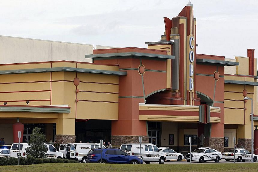 Law enforcement vehicles are parked outside the Cobb Grove 16 movie theatre in Wesley Chapel, Florida on Jan 13, 2014. A 71-year-old retired policeman was refused bail on Tuesday after allegedly shooting dead a fellow moviegoer in Florida for using t