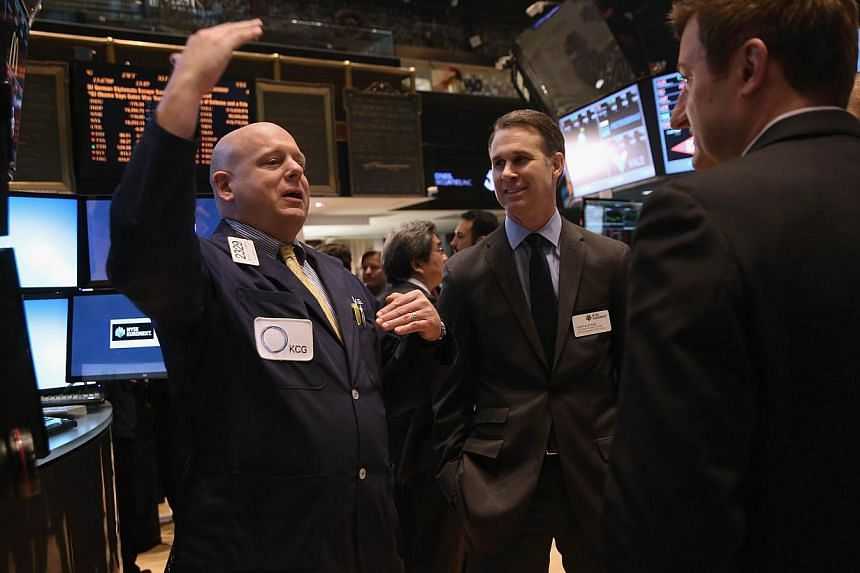 Traders work the floor of the New York Stock Exchange at the end of the trading day on Jan 13, 2014 in New York City. US stocks closed solidly higher on Tuesday, buoyed by a better-than-expected report on December retail sales covering the holiday sh