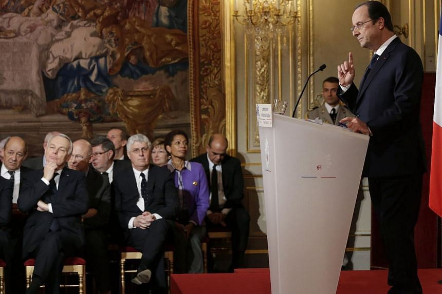 French President Francois Hollande (right) speaks as members of the government listen during a news conference at the Elysee Palace in Paris, on Jan 14, 2014.France will not tolerate any hate speech or acts against Jews, Muslims or Christians,