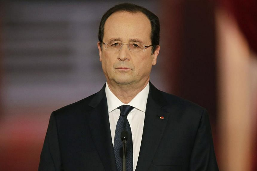 French President Francois Hollande listens to question during a news conference at the Elysee Palace in Paris, on Jan 14, 2014. French President Francois Hollande admitted on Tuesday he was going through a painful time in his private life but re