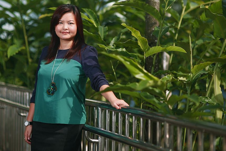 New Punggol-East Member of Parliament (MP) Lee Li Lian at the rooftop of 156A Rivervale Crescent on Feb 28, 2013. Ms Lee is pregnant and expecting a baby girl - her first child - later this year.-- ST FILE PHOTO: TED CHEN