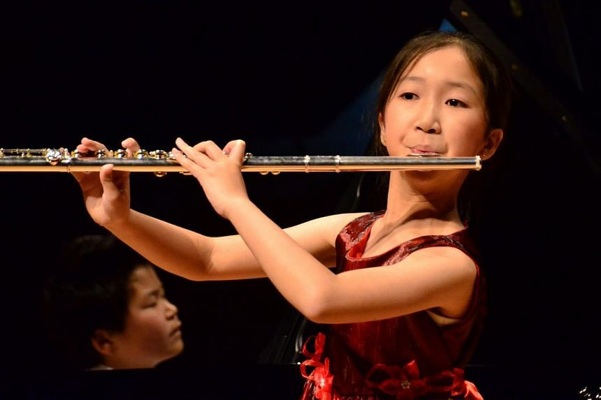 Ong Yi Ting, flutist from Singapore,performed at theChildAid Asia Tokyo 2014 concert at Suntory Hall on January 11, 2014. -- PHOTO:THE OLD PARLIAMENT HOUSE