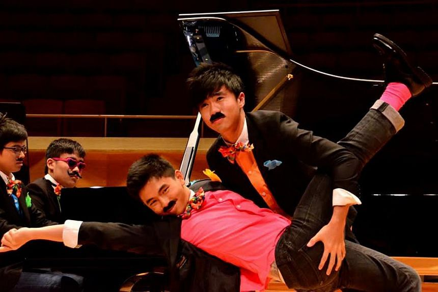 """Animato Quad, a four-member piano ensemble from Singapore, performed an """"eight hands"""" pieceat theChildAid Asia Tokyo 2014 concert at Suntory Hall on January 11, 2014. -- PHOTO:THE OLD PARLIAMENT HOUSE"""