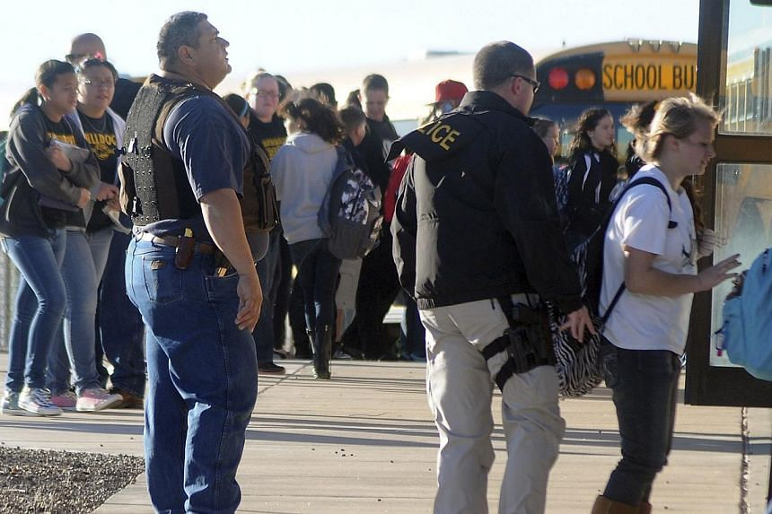 Students are escorted from Berrendo Middle School following an early morning shooting in Roswell, New Mexico, on Jan 14, 2014. -- PHOTO: REUTERS