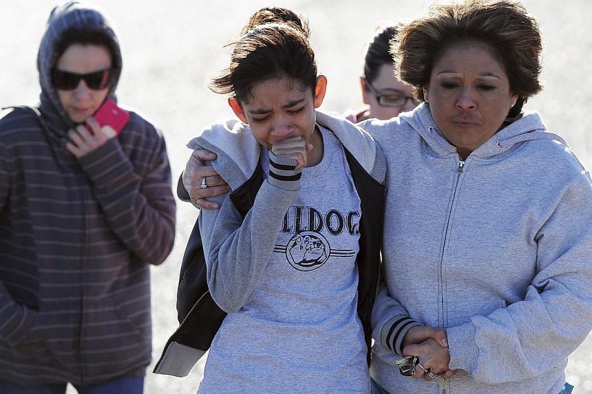 Students are reunited with family following an early morning shooting at Berrendo Middle School in Roswell, New Mexico, on Jan 14, 2014. -- PHOTO: REUTERS