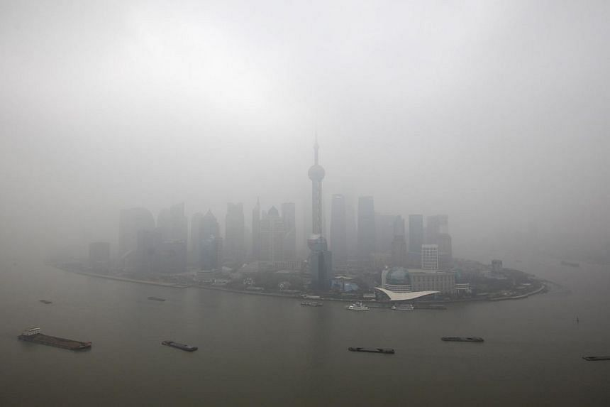 The financial district of Pudong is seen on a hazy day in Shanghai, on Jan 21, 2013. China's commercial capital, Shanghai, introduced emergency measures to tackle air pollution on Wednesday, Jan 15, 2014, allowing it to shut schools and order