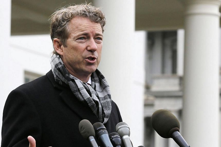 """United States (US) Representative Rand Paul, a Republican from Kentucky, speaks outside the White House after President Barack Obama announced the first five """"Promise Zones"""", as a way to create jobs, in Washington on Jan 9, 2014. Several US lawmakers"""