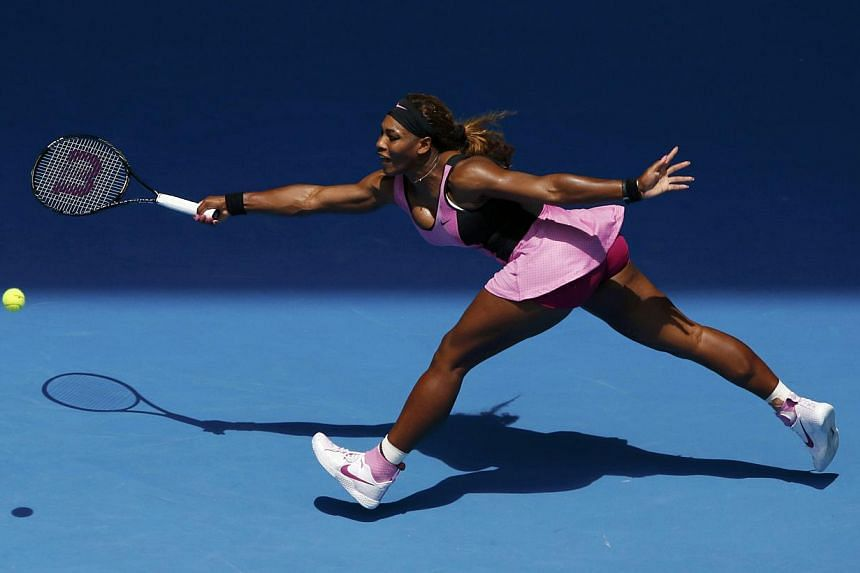Serena Williams of the US hits a return to Vesna Dolonc of Serbia during their women's singles match at the Australian Open 2014 tennis tournament in Melbourne on Jan 15, 2014. Williams stayed on track for her sixth Australian Open title on Wednesday