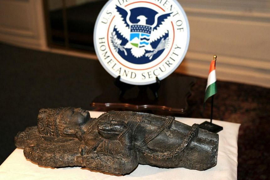 A sculpture is displayed during a repatriation ceremony on Jan 14, 2014, at the Consulate General of India in New York. The United States returned to India on Tuesday three ancient sculptures that had fallen into the hands of traffickers, following a