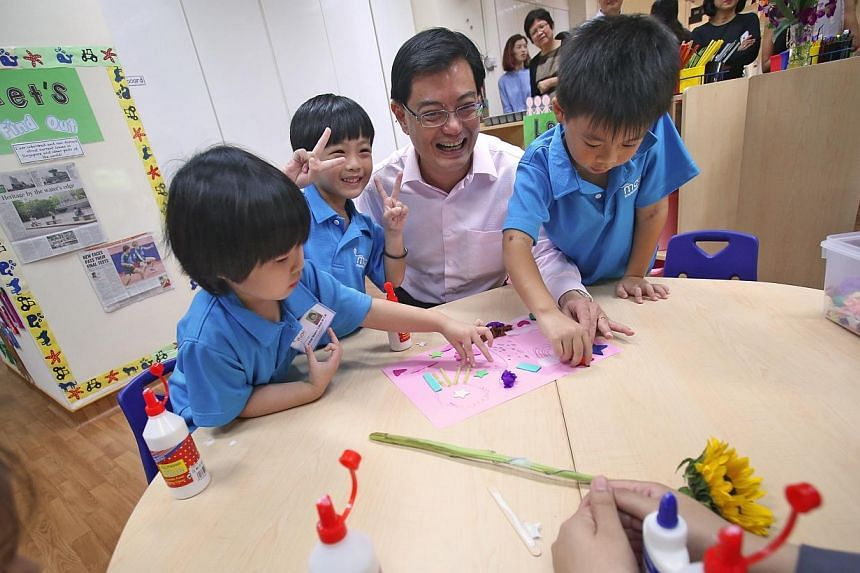 """Education Minister Heng Swee Keat at the MOE Kindergarten @ Tampines on Jan 7, 2014.The Ministry of Education hopes to nurture children in its new kindergartens to be """"confident, lively and curious"""", Mr Heng said in a Facebook post on Wednesday"""