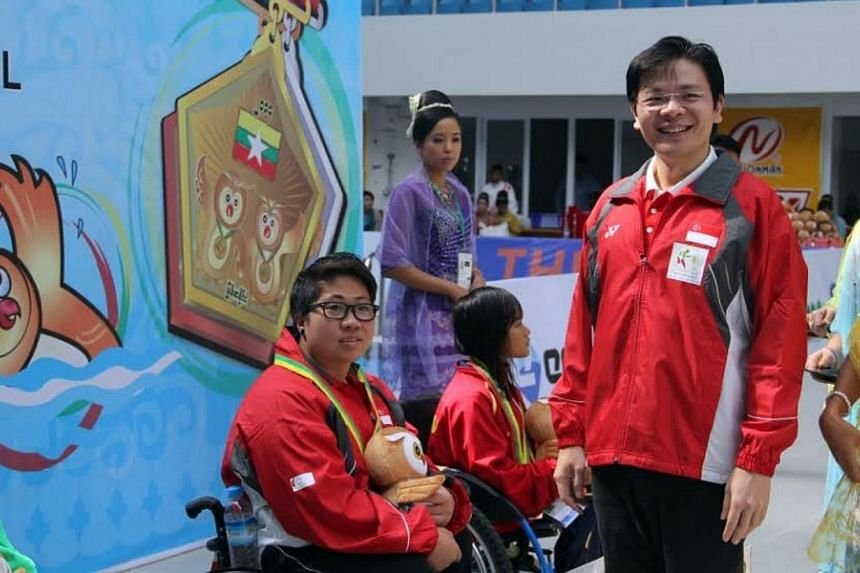 Swimmer Theresa Goh (left) with Acting Minister for Culture, Community and Youth Lawrence Wong. Goh claimed Singapore's first gold medal at the Asean Para Games in Naypyitaw, Myanmar, after a stunning performance in the women's 50m breaststroke (SB4)