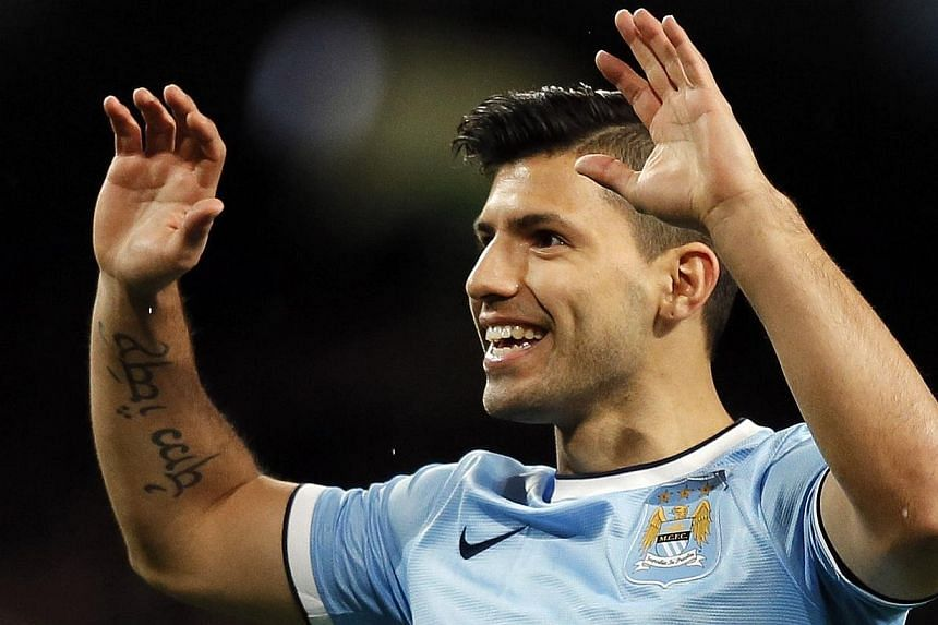 Manchester City's Sergio Aguero celebrates scoring during their FA Cup third round soccer match against Blackburn Rovers at the Etihad stadium in Manchester, northwest England on Jan 15, 2014.Aguero marked his comeback with a goal as Manchester