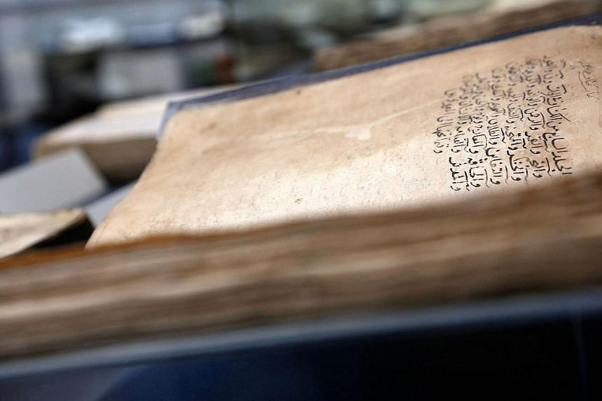 A view of an old manuscript on display during the re-opening ceremony of the Gazi Husrev-bey library in Sarajevo, on Jan 15, 2014. -- PHOTO: AFP