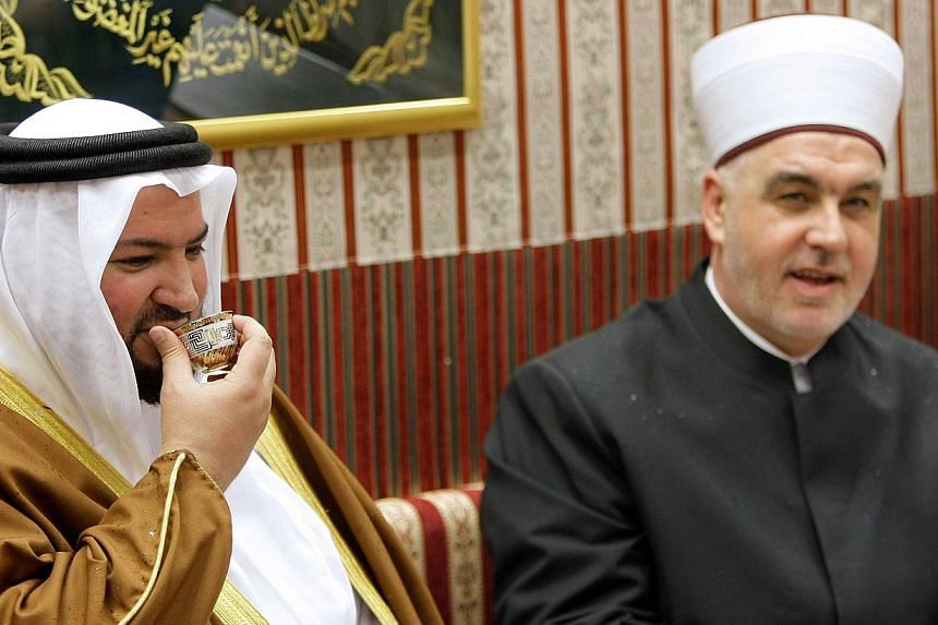 Bosnian Grand Mufti, Husein Kavazovic (right), and Qatar's state Minister of Awqaf and Islamic Affairs, Ghaith bin Mubarak Al Kuwariduring (left), drink a traditional cup of coffee together, during the re-opening ceremony of the Gazi Husrev-bey libra