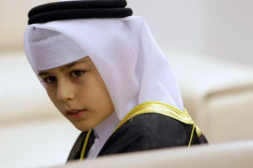 A Bosnian Muslim boy looks on during the re-opening ceremony of the Gazi Husrev-bey library in Sarajevo, on Jan 15, 2014. -- PHOTO: AFP