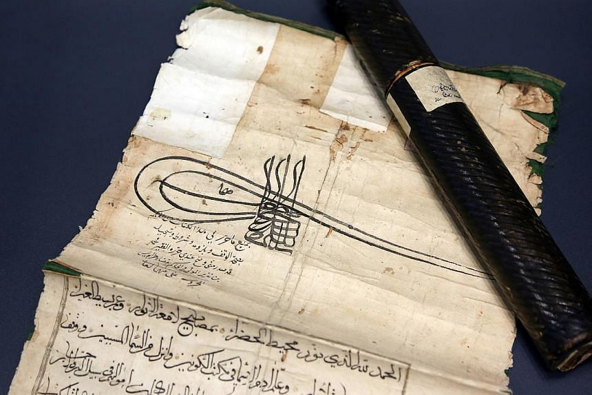 A view of an old manuscript on display during the re-opening ceremony of the Gazi Husrev-bey library in Sarajevo, on Jan 15, 2014. Bosnia opened on Wednesday a new library to house its ancient Islamic manuscripts, which were saved from destructi