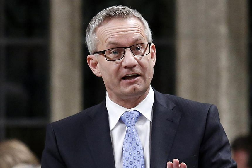Canada's International Trade Minister Ed Fast speaks during Question Period in the House of Commons on Parliament Hill in Ottawa on Nov 27, 2013. Canada wants to double the number of foreign students enrolled at its universities as well as researcher