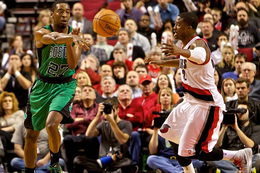 Boston Celtics shooting guard Jordan Crawford (27) passes away from Portland Trail Blazers shooting guard Wesley Matthews (2) at the Moda Center.The Golden State Warriors acquired Crawford and MarShon Brooks from the Boston Celtics on Wednesday